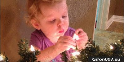 christmas-tree-candles-blow-out-child